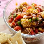 Image of Chopped Taco Salad in a glass bowl with Tortilla Chips