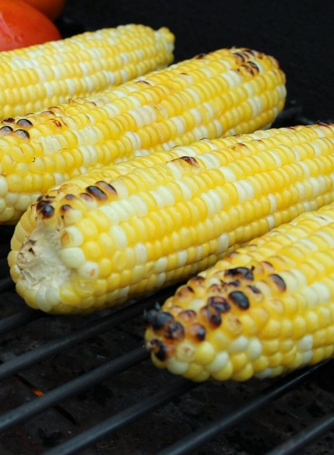 Ears of corn with char marks on grill grates