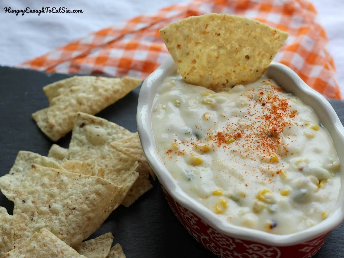 Image of Grilled Corn & Jalapeno Queso in a bowl with tortilla chips