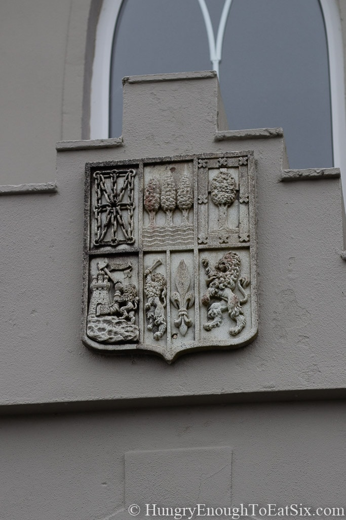 Image of coat of arms over doorway at Rossmore Manor