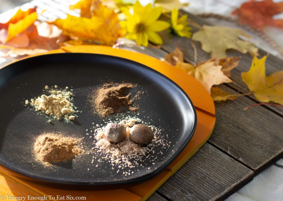 Ground spices on a black plate