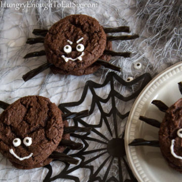 Chocolate sandwiched cookies with decorations to look like spiders