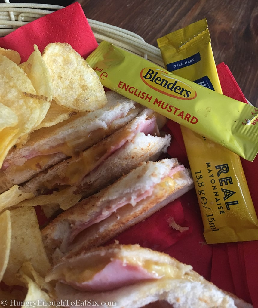 Ham, cheese and onion toastie with Tayto brand chips, served at Charlie Chaplin's Pub in Limerick Ireland.