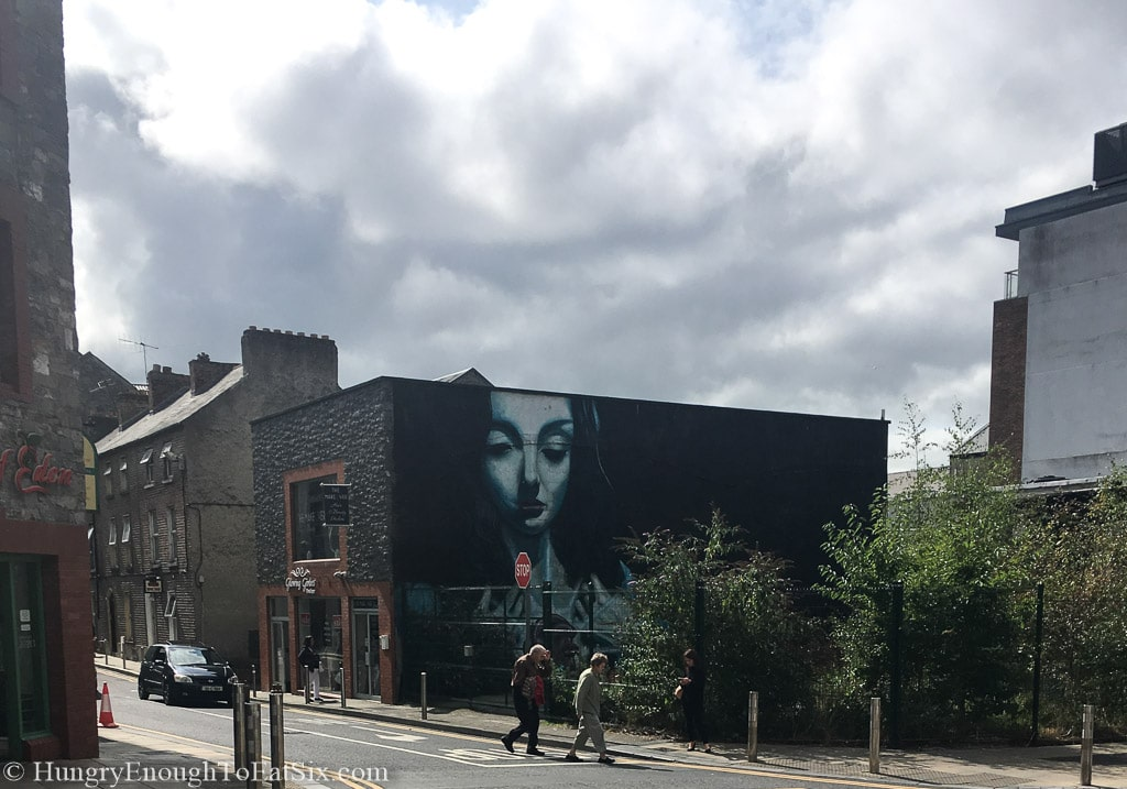 Building in Limerick, Ireland with an illustration of a face on the side.