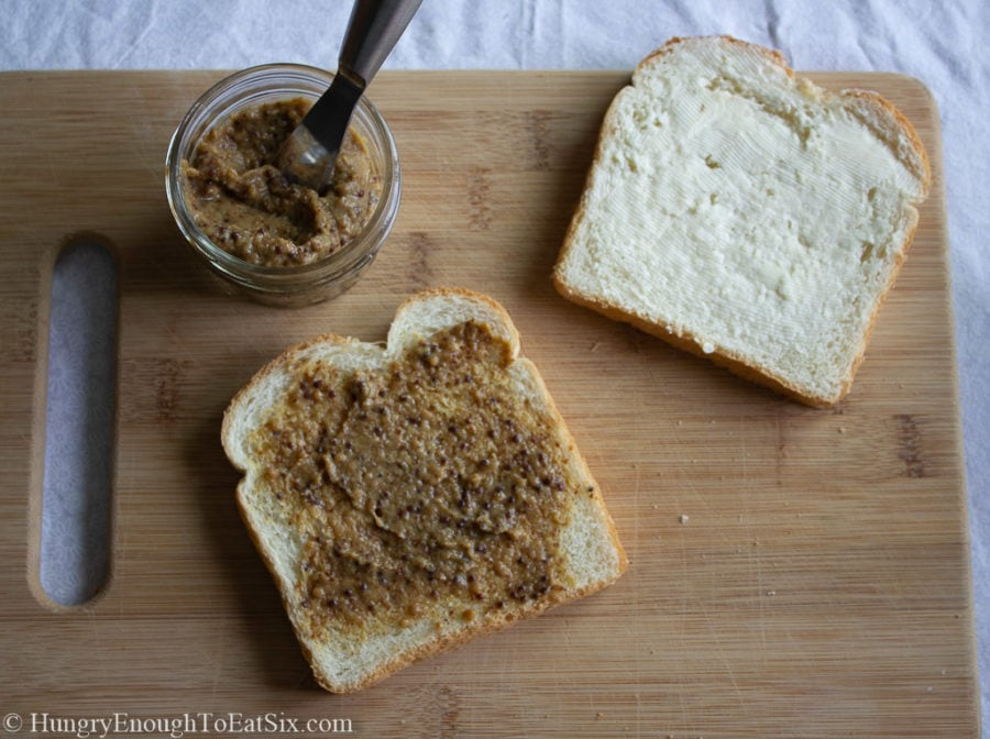 White bread slices spread with butter and pub mustard.