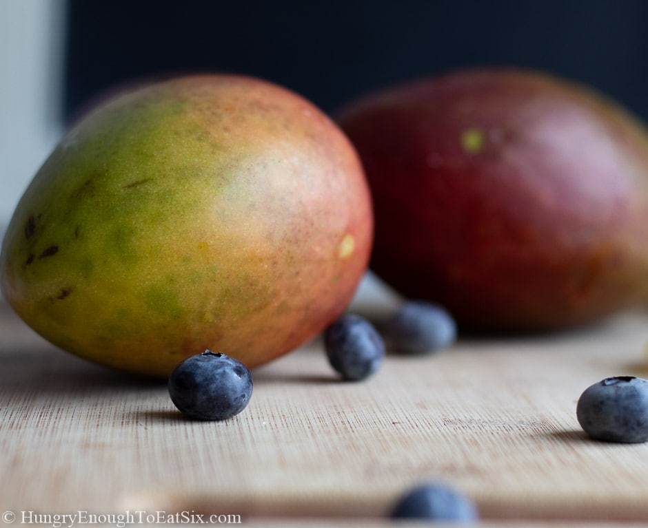 Image of mangoes and a few blueberries
