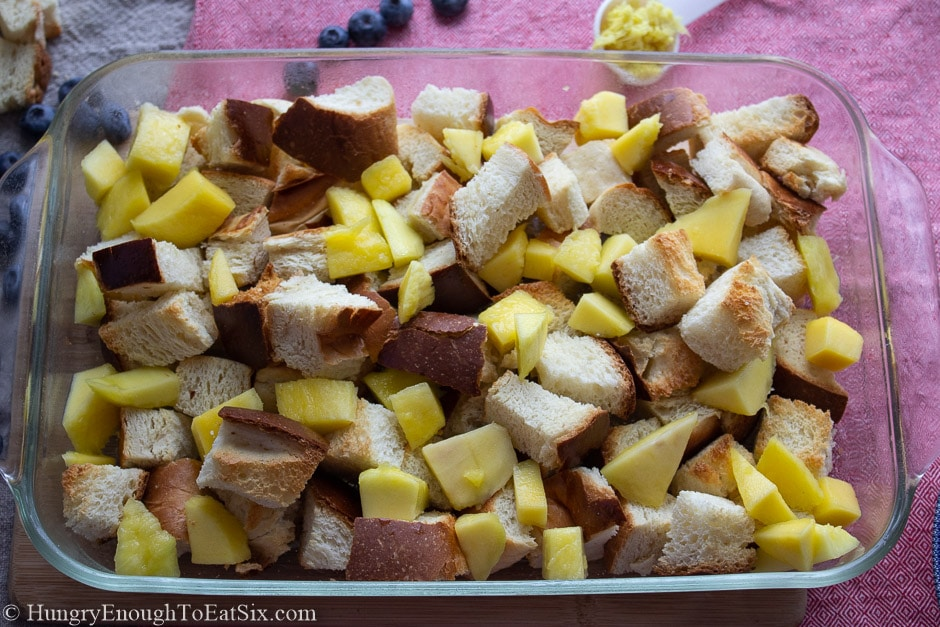 Image of bread cubes and mango in a pan