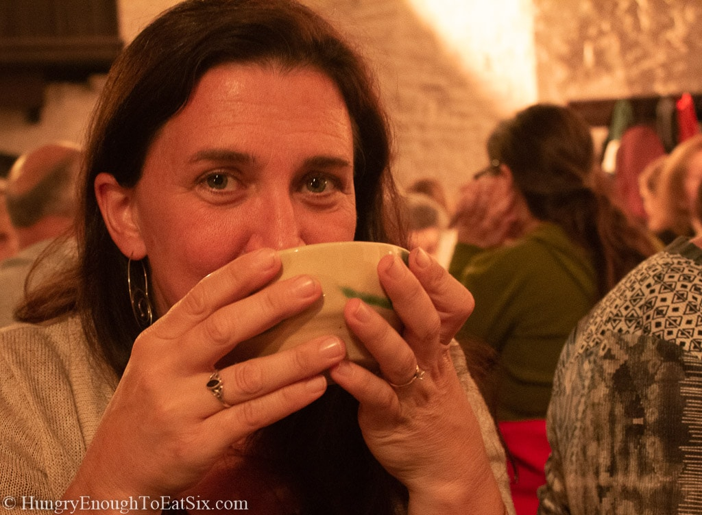 Image of me sipping soup from a bowl at Bunratty castle