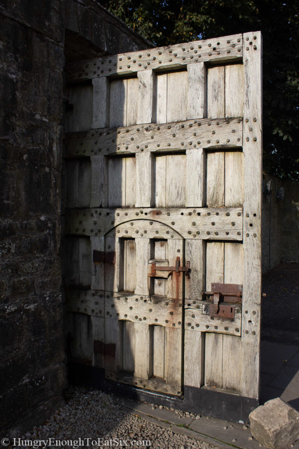 Image of large wooden door at the gate of Bunratty Castle