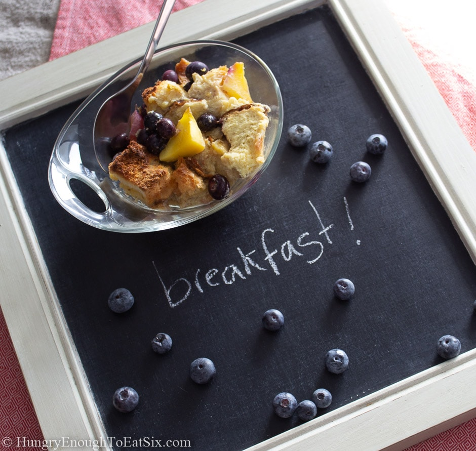 Image of a dish of bread pudding on a chalkboard background