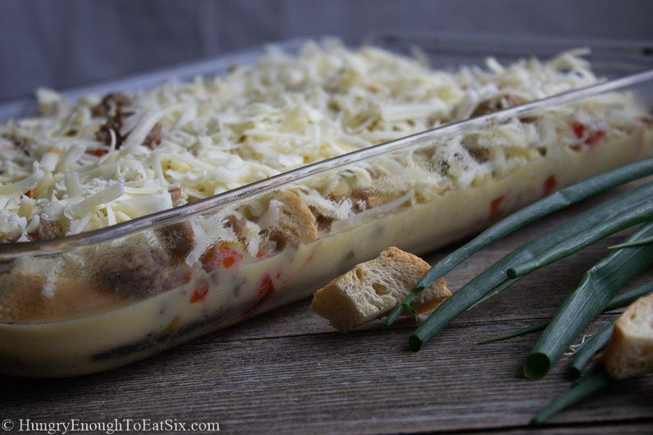 Image of pan of sausage, vegetables, and cheese with egg batter