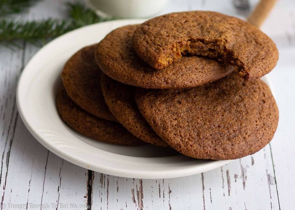 White plate with molasses cookies stacked