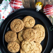 Round brown cookies on a black round plate