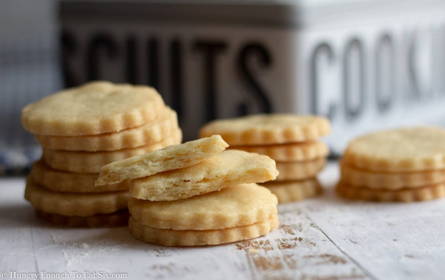 Plain cookies in front of a biscuit tin