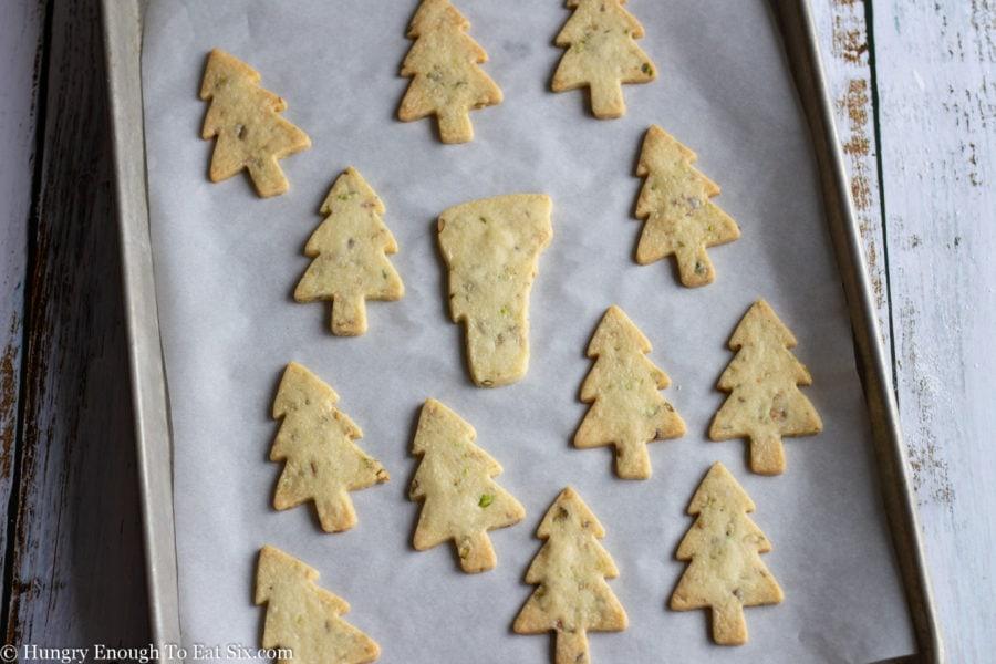 Cookie dough cutouts on a baking sheet