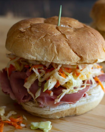 Corned beef sandwiches with slaw on rolls.