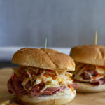 Corned beef sandwiches with slaw on potato rolls.