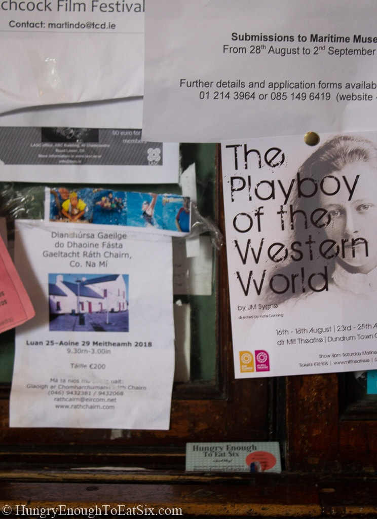 Posters and fliers on a public board