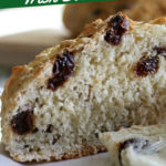 Sliced open loaf of soda bread with raisins