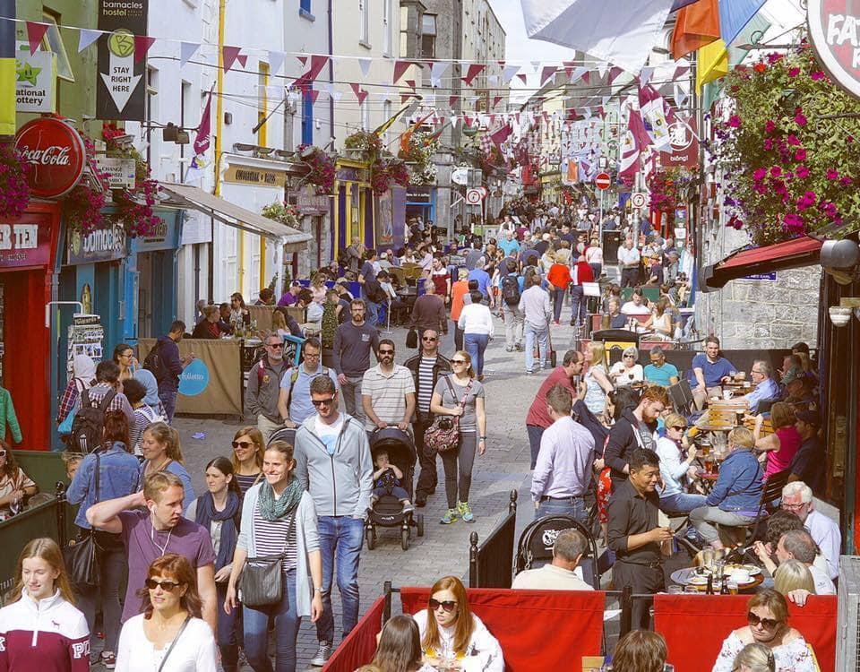 Crowds of people walking along a street
