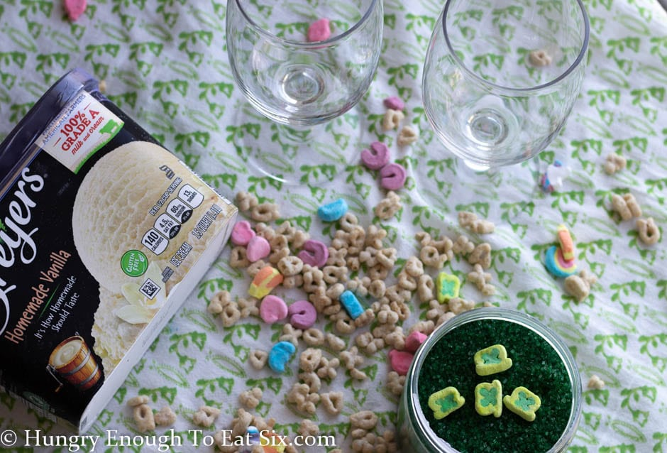 Cereal and glasses on a green and white cloth