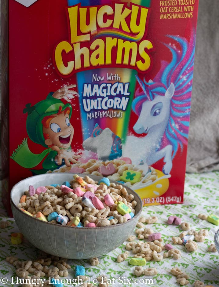 Red cereal box behind bowl of cereal