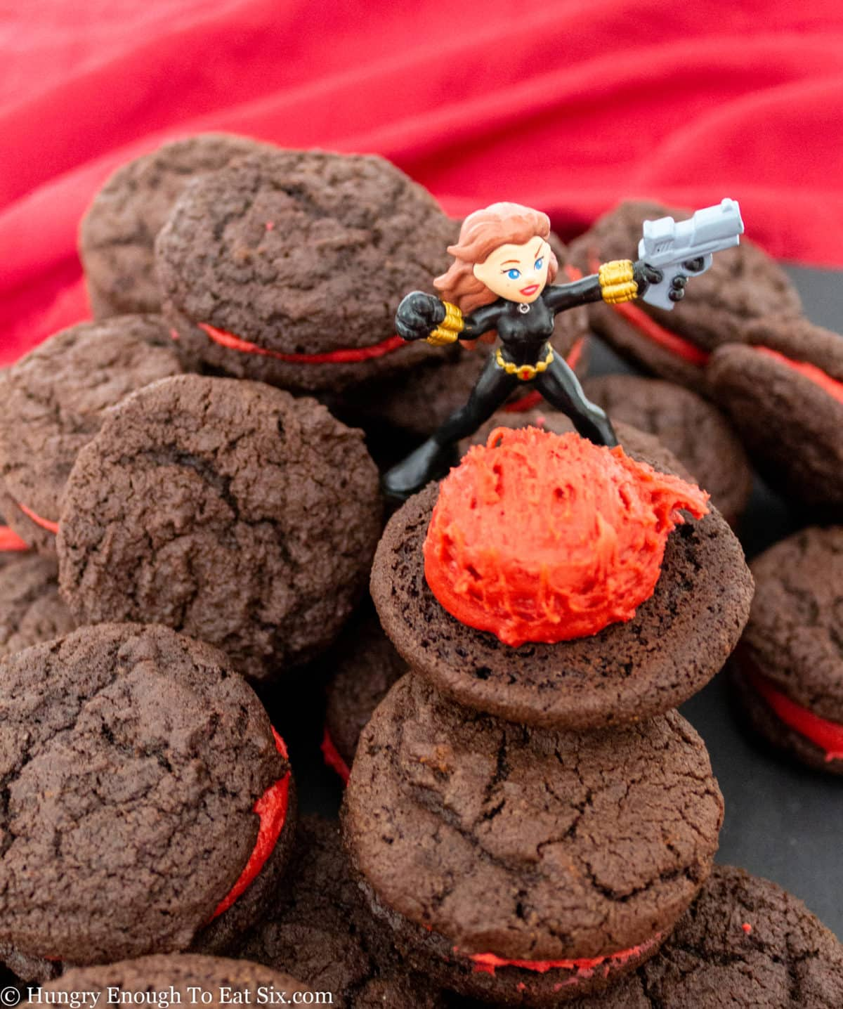 Chocolate cookies with a scoop of red frosting
