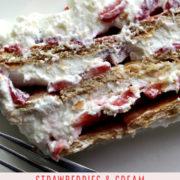 Icebox cake with layers of graham crackers, strawberries and cream.
