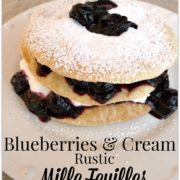 Stack of pastry, blueberries and cream