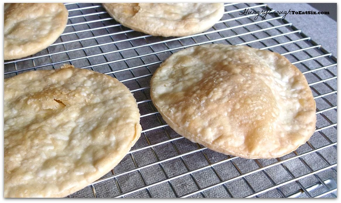 Baked pastry rounds on a cooling rack