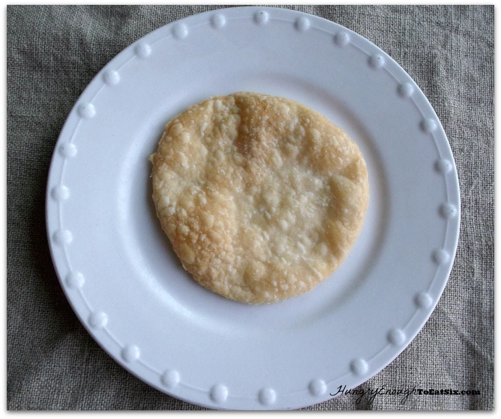 Round pastry on a white plate