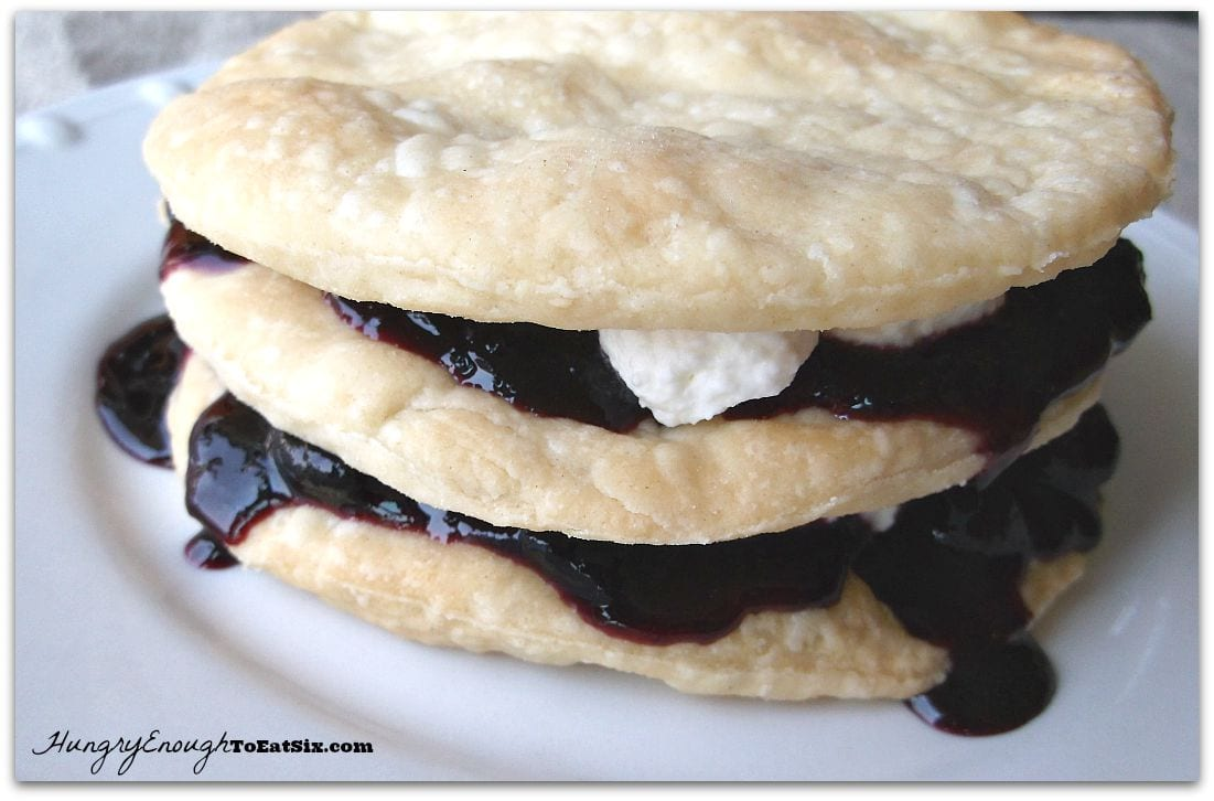 Plain pastry layers with blueberry sauce and whipped cream