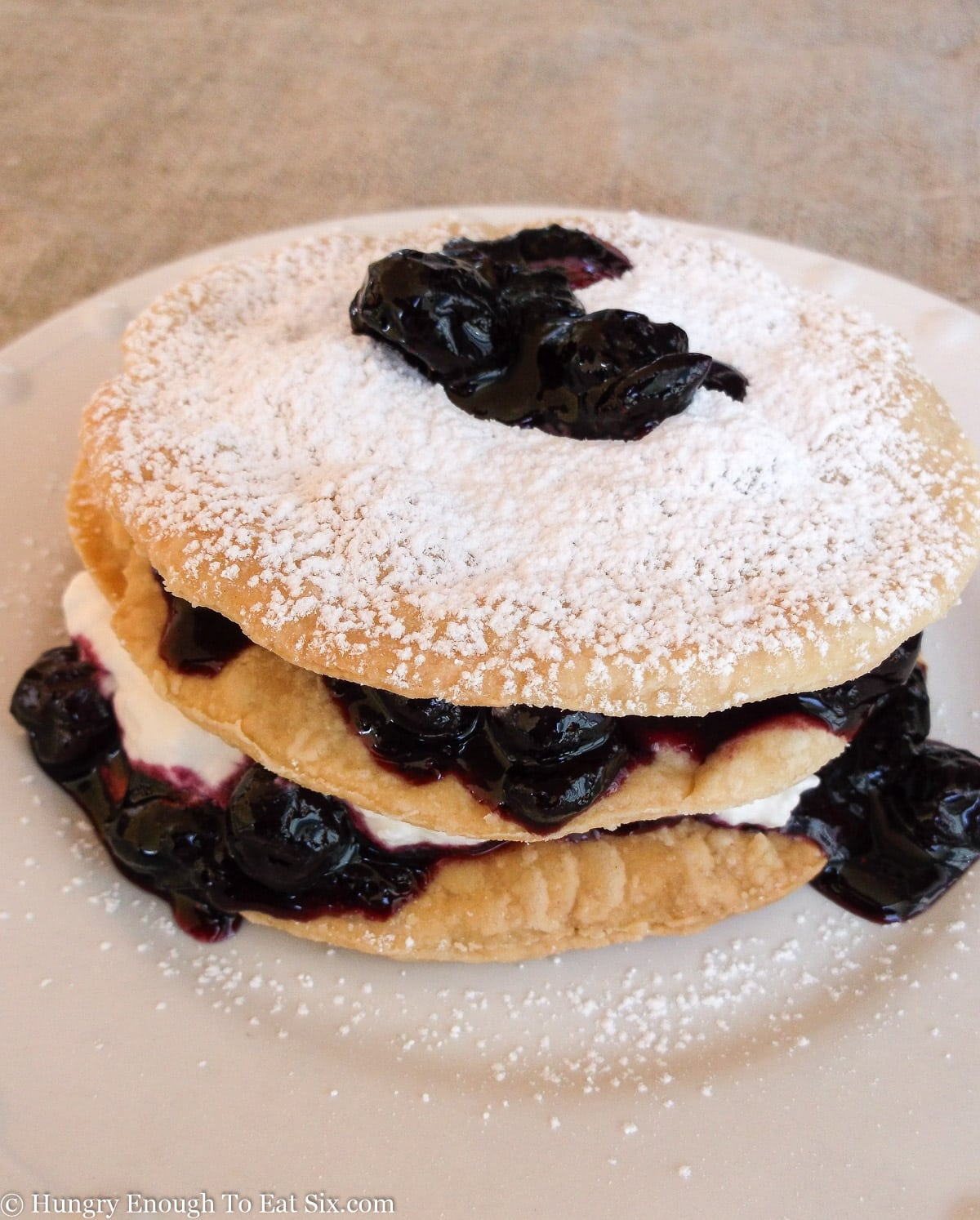 White plate with pastry fruit and cream