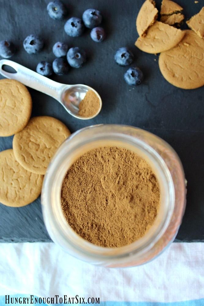 Jar of cinnamon near gingersnap cookies