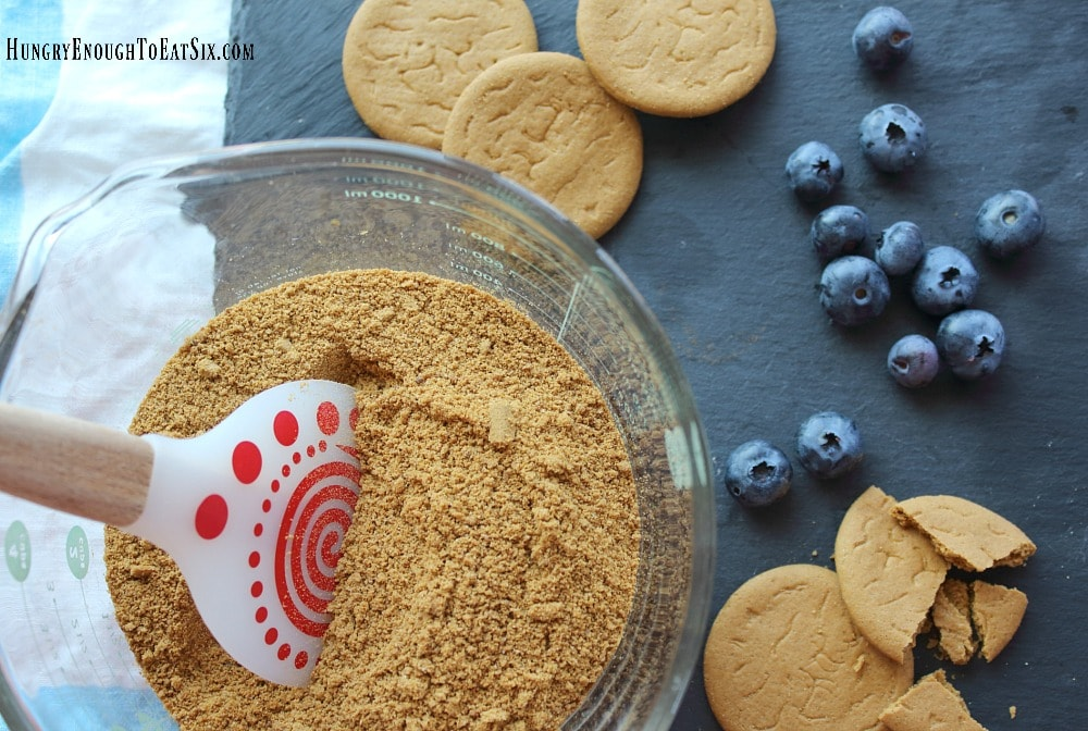 Gingersnap cookie crumbs in a bowl