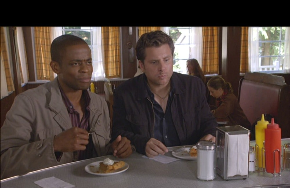 Image from psych tv show of two men eating at a counter