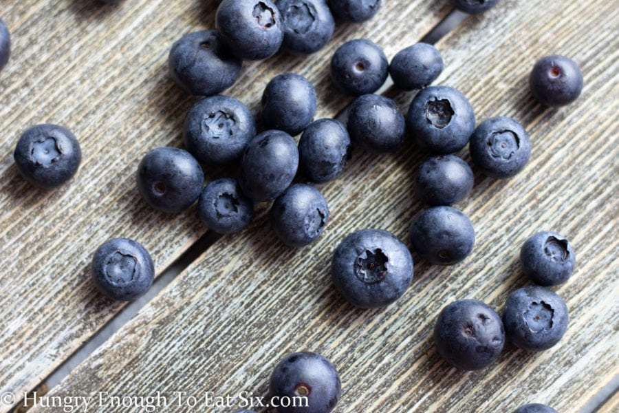 Blueberries on a wood surface.
