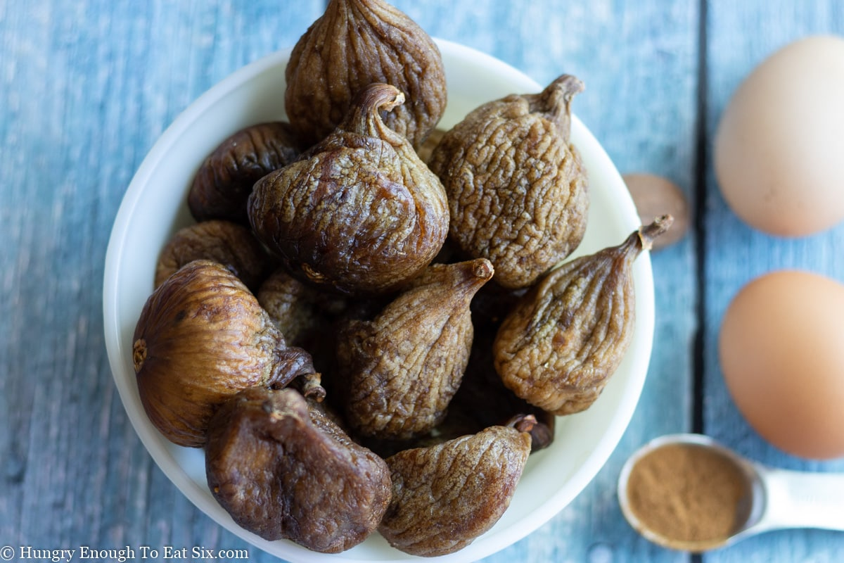 White bowl of whole dried figs
