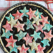 Dark fruit tart with red and blue pastry stars