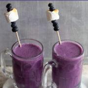 Two glass mugs of purple milkshake