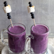 Purple milkshakes in glass mugs