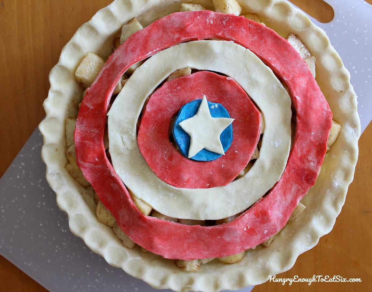 Unbaked apple pie with red, white and blue concentric circles