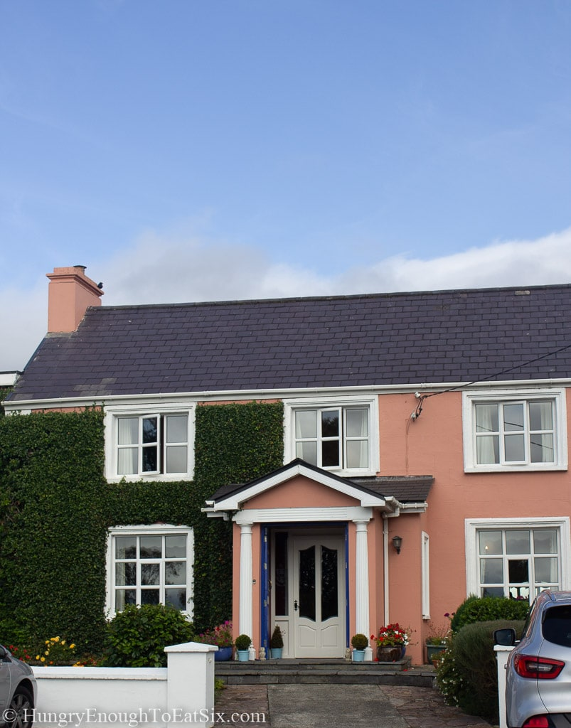 House with salmon pink walls and ivy.