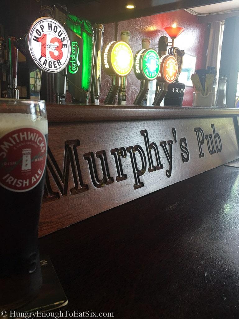 Beer taps behind a bar