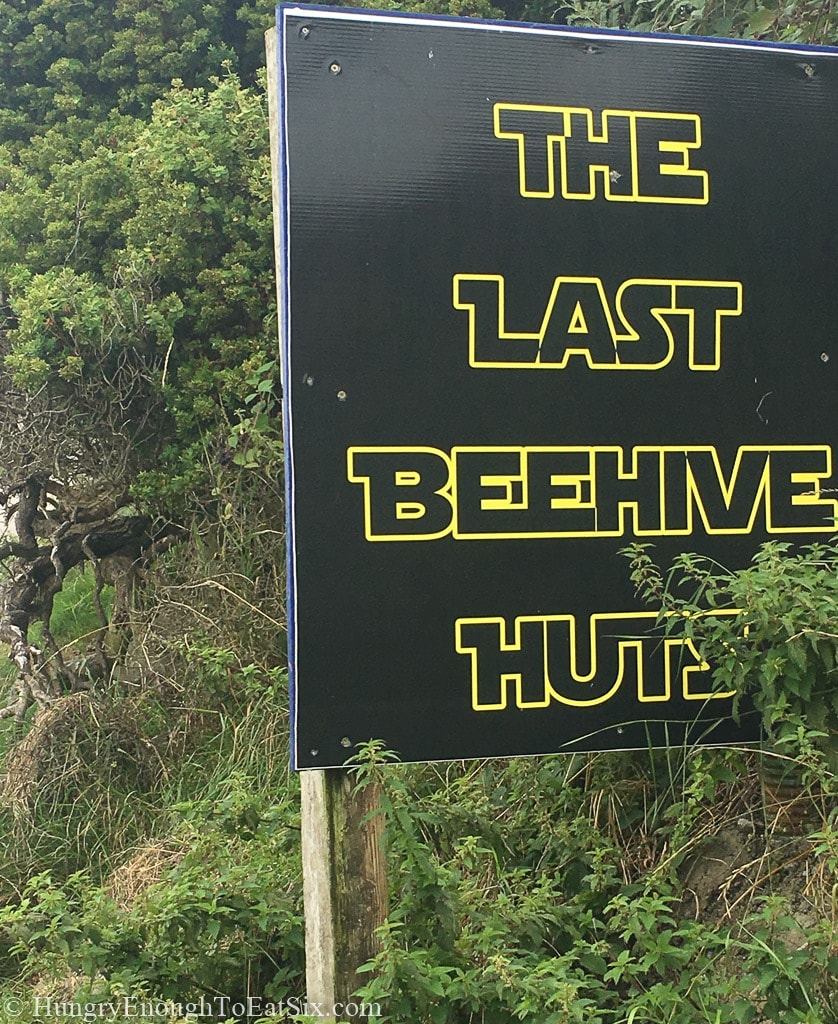 Black and yellow roadside sign
