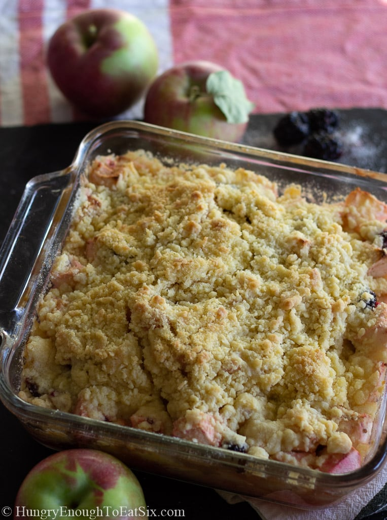Glass pan holding crumble topped dessert