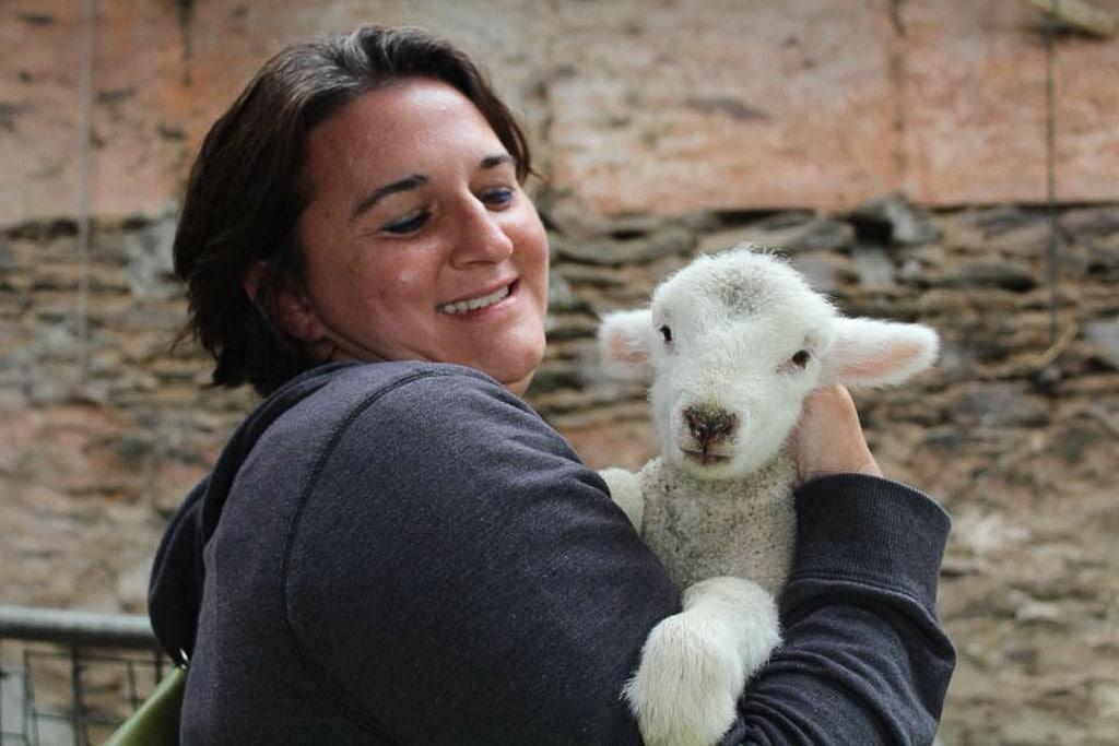 Woman holding a lamb
