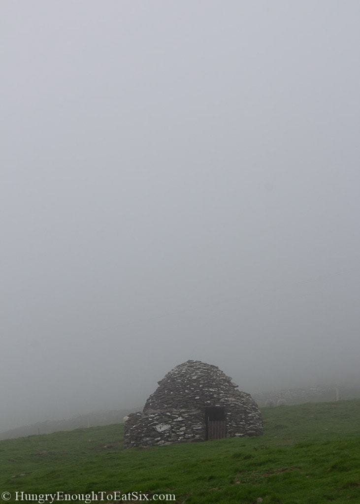 Stone hut in the fog
