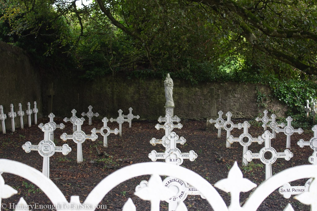 White crosses in a yard under trees