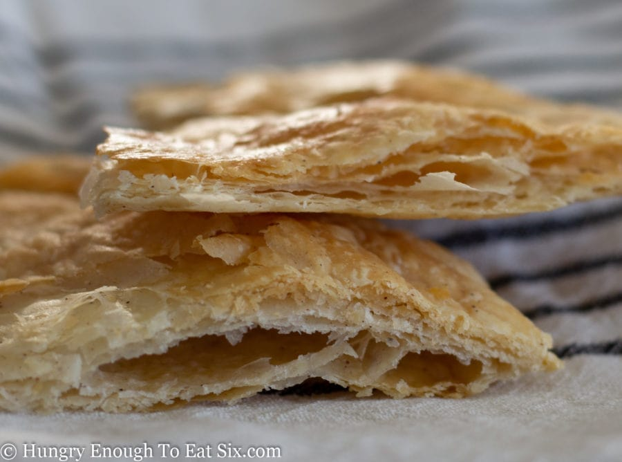 Baked pieces of flaky pie crust showing the layers